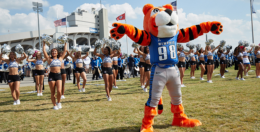 Pouncer, the Tiger's mascot, and cheerleaders