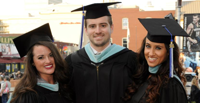 three students graduating