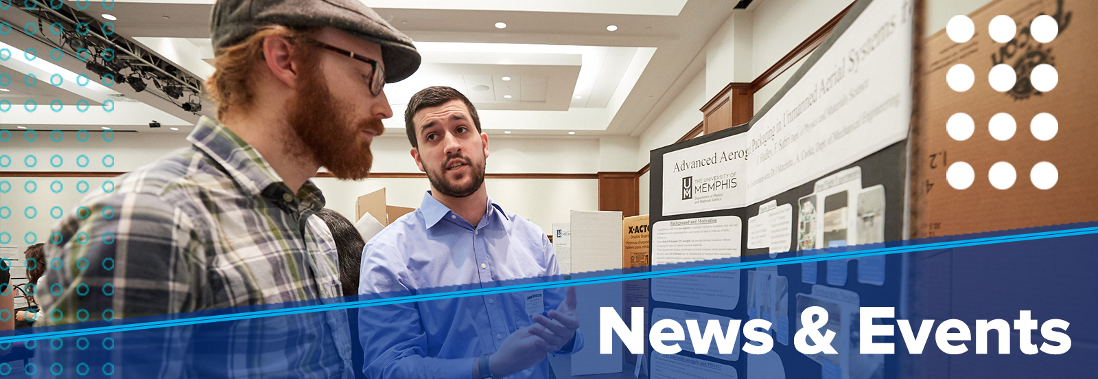 News & Events (photo of student presenting research board to other student)