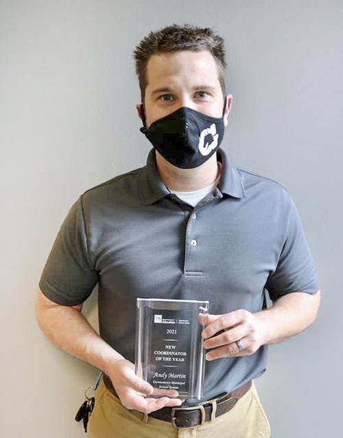 Andy Martin holding award