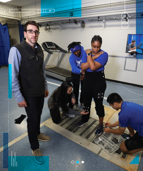 Max Paquette in lab with students