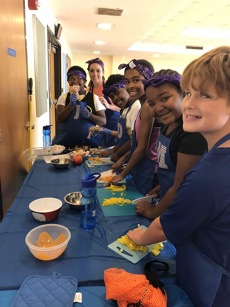 Campers learn to chop fruit