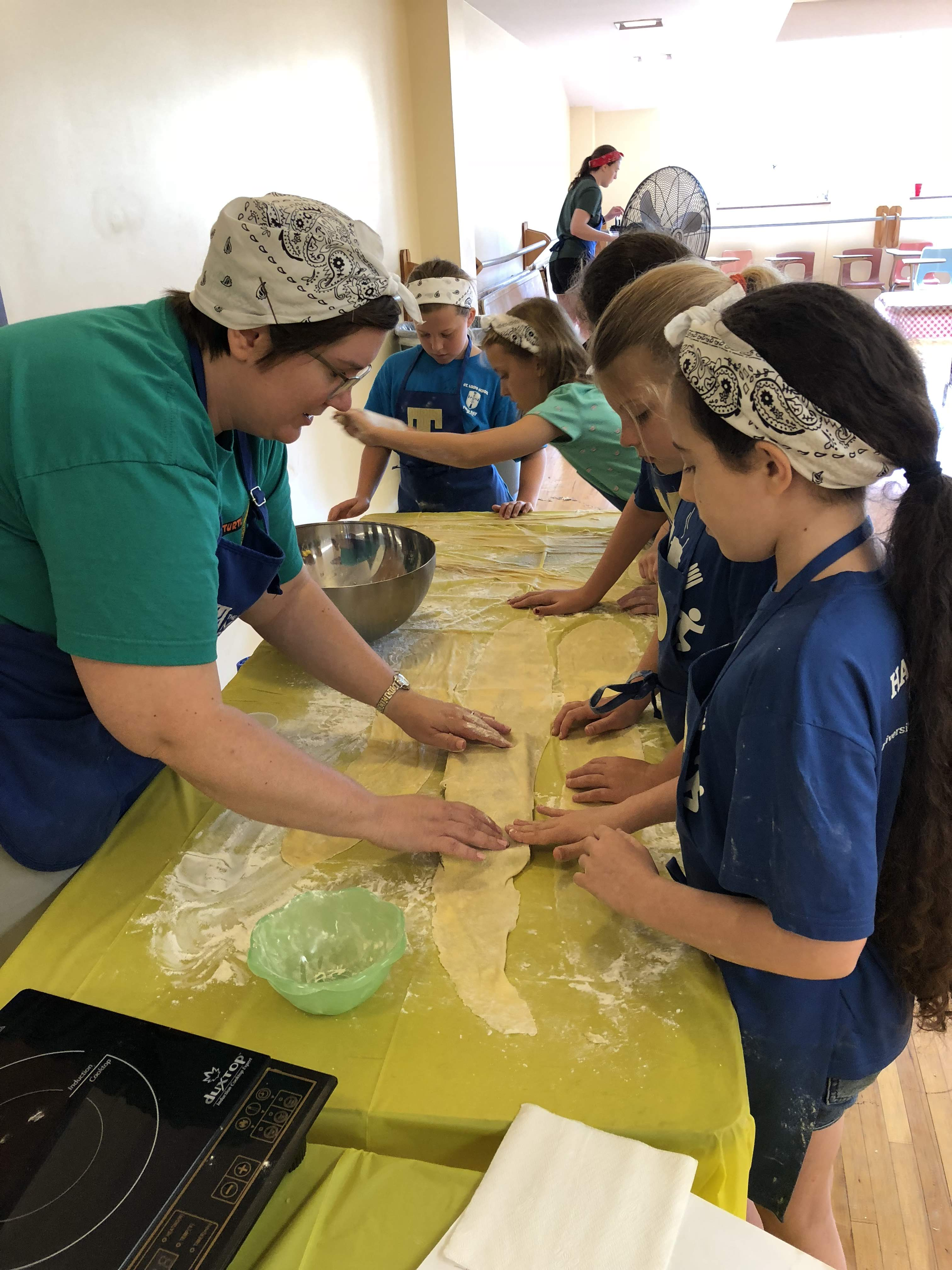 Student helps campers