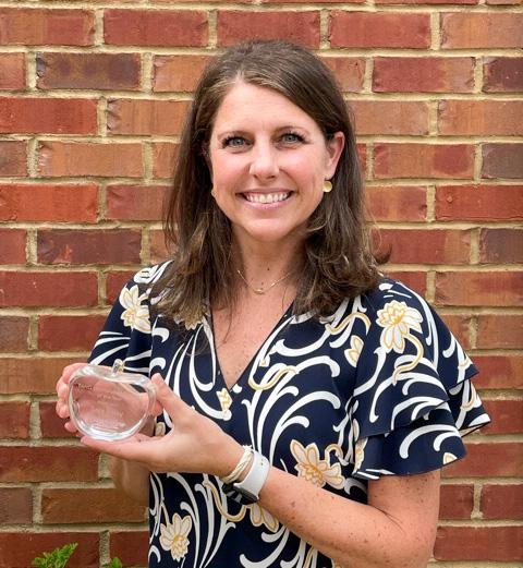 Sara Foley holding TAND award