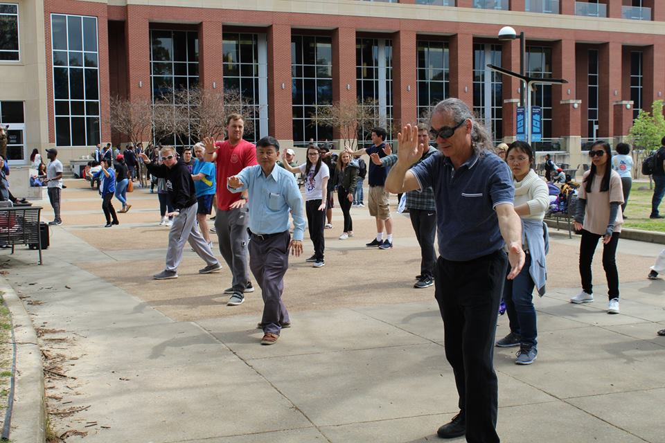 MR. Michael Coplon instructs student in Tai Chi