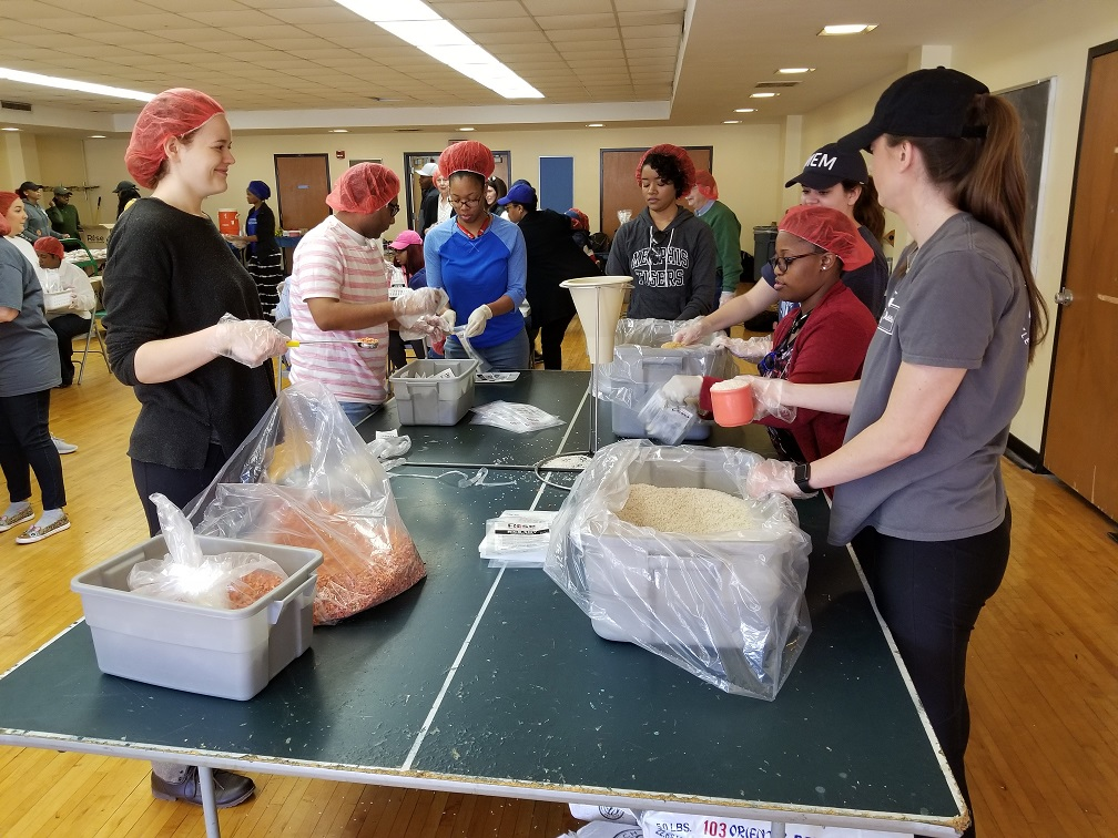 Students package meals for Rise Against Hunger 2018.