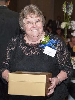 Jan Sherman receiving her commemorative gift