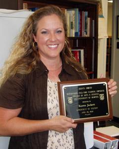 Karen Jackett with award