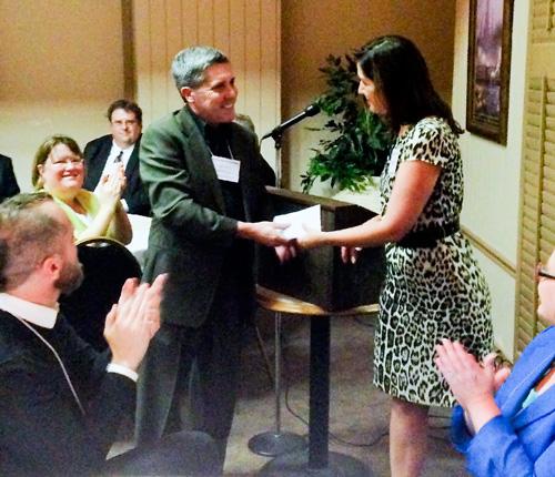 Dr Marler receiving prize