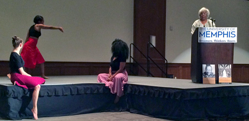 Dr Bond and dancers interpreting her narrative