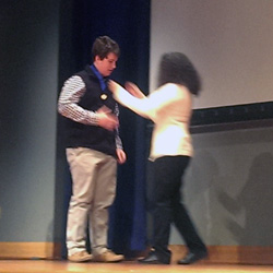 Awards ceremony, student receiving medal