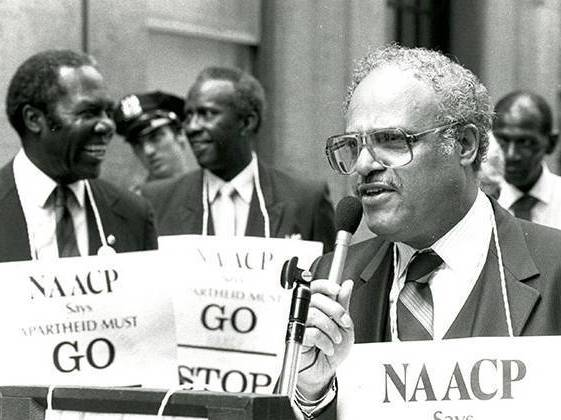Hooks Hold NAACP sign