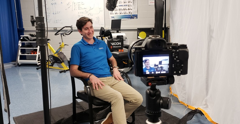 Photo of Dr. Daniel Greenwood sitting in front of a camera