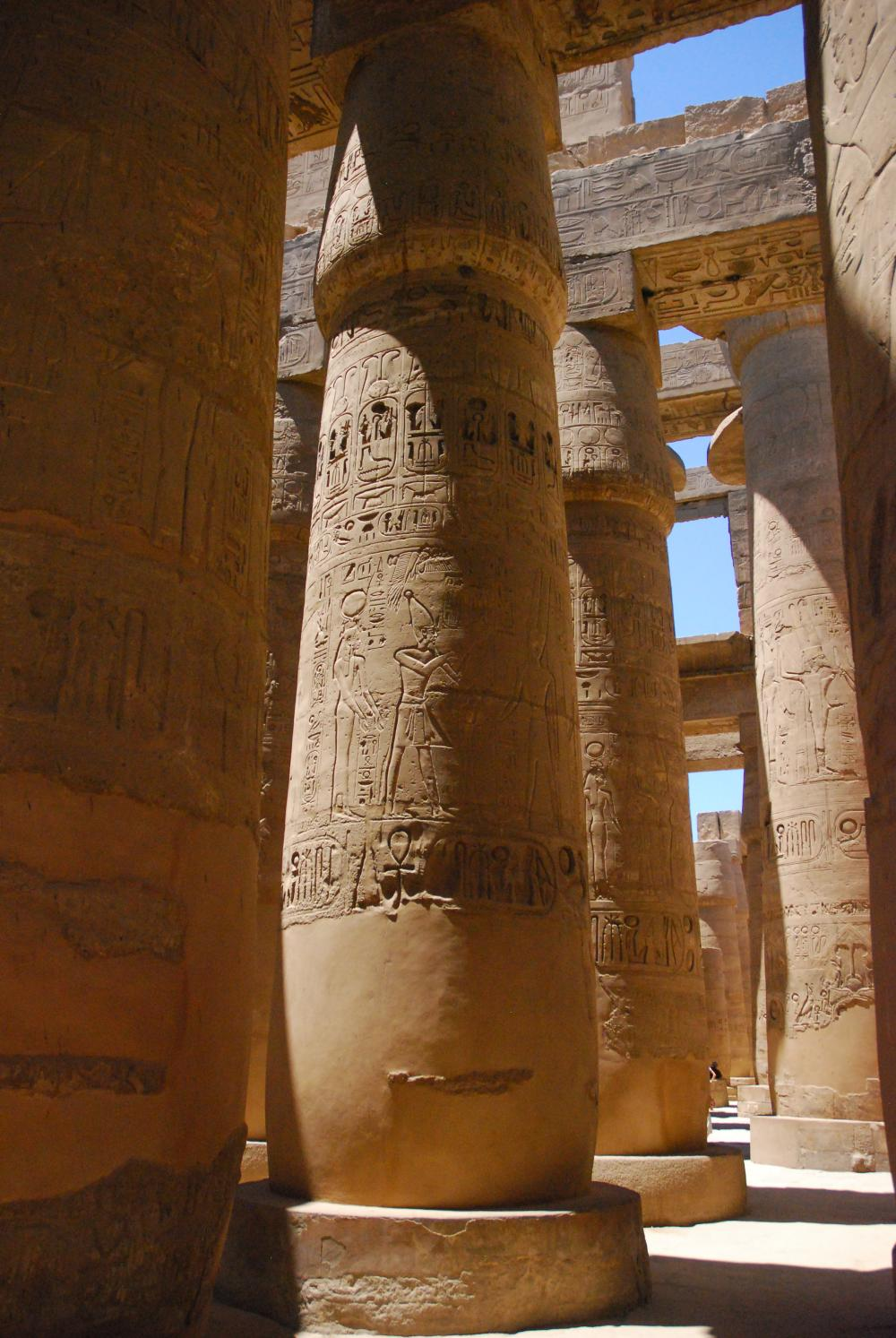 View of the larger columns with architraves still in situ and the remains of a clerestory window in the background (left) and smaller columns (right).