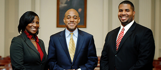Frederick Douglass Moot Court Team, from left to right, LaChina Alger, coach Andre Mathis, and Joseph McKinney.