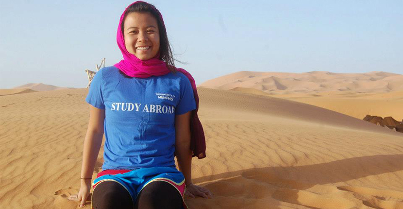 Study Abroad student among the sand dunes