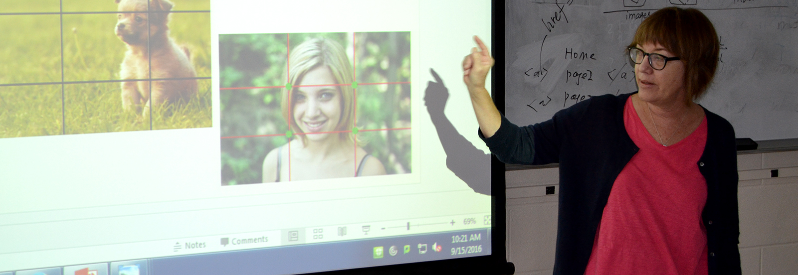 """Prof. Pam Denney explains the """"Rule of Thirds"""" to her class."""