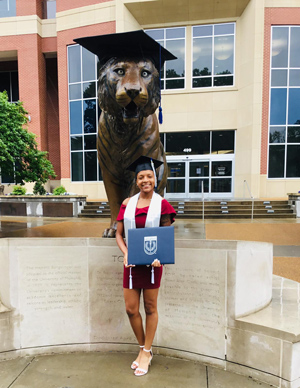 Chanel after graduation with bronze tiger statue