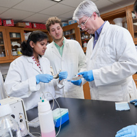 biomedical engineer professor and 2 students