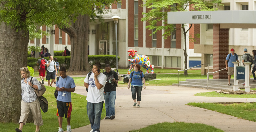 students walking around main campus front Mitchell Hall