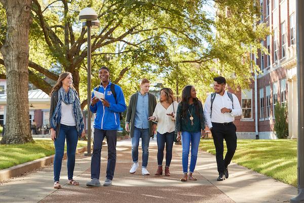 group of ELs Walking down a sidewalk