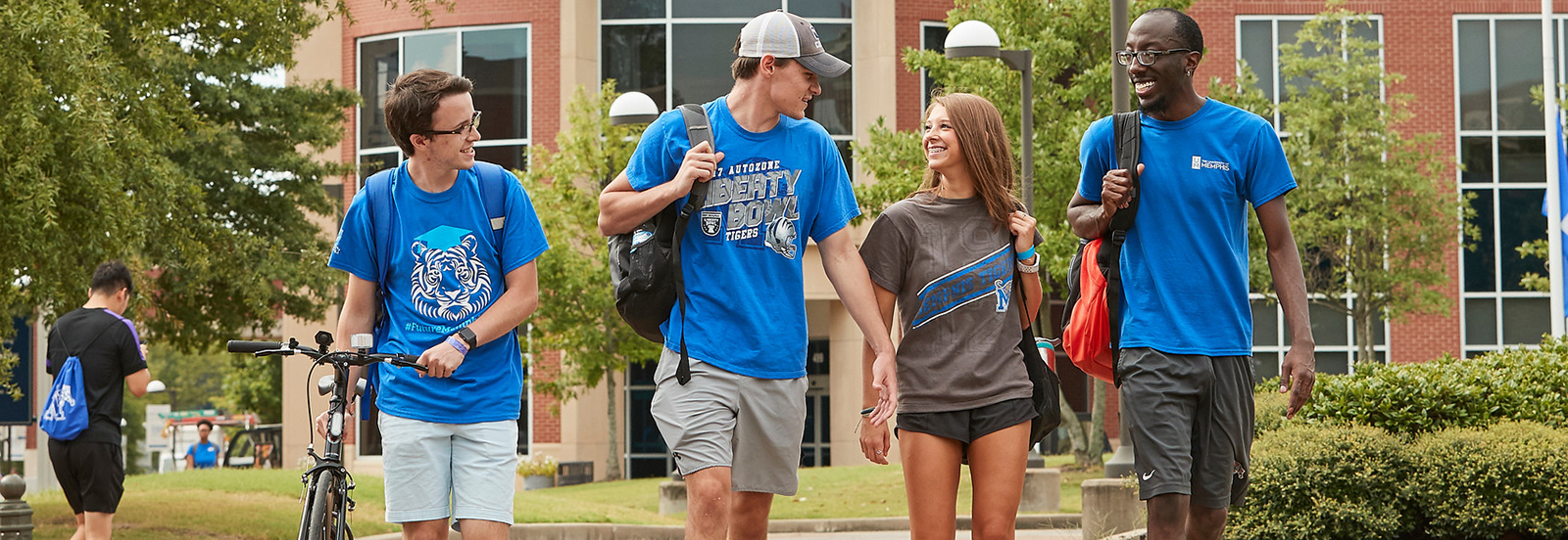 4 students walking on campus
