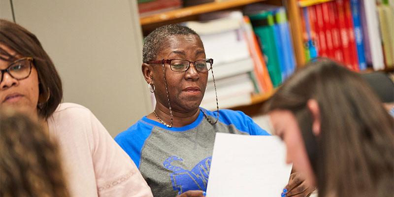 Older student reading a form