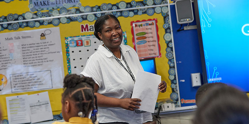 Older teacher working with class