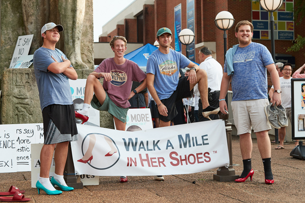 """participants in the """"Walk a Mile in Her Shoes"""" event"""
