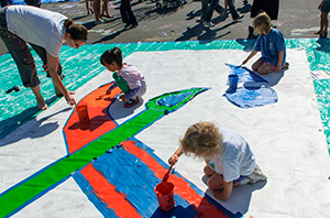 children painting canvas