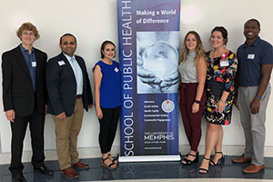 MPH students with banner