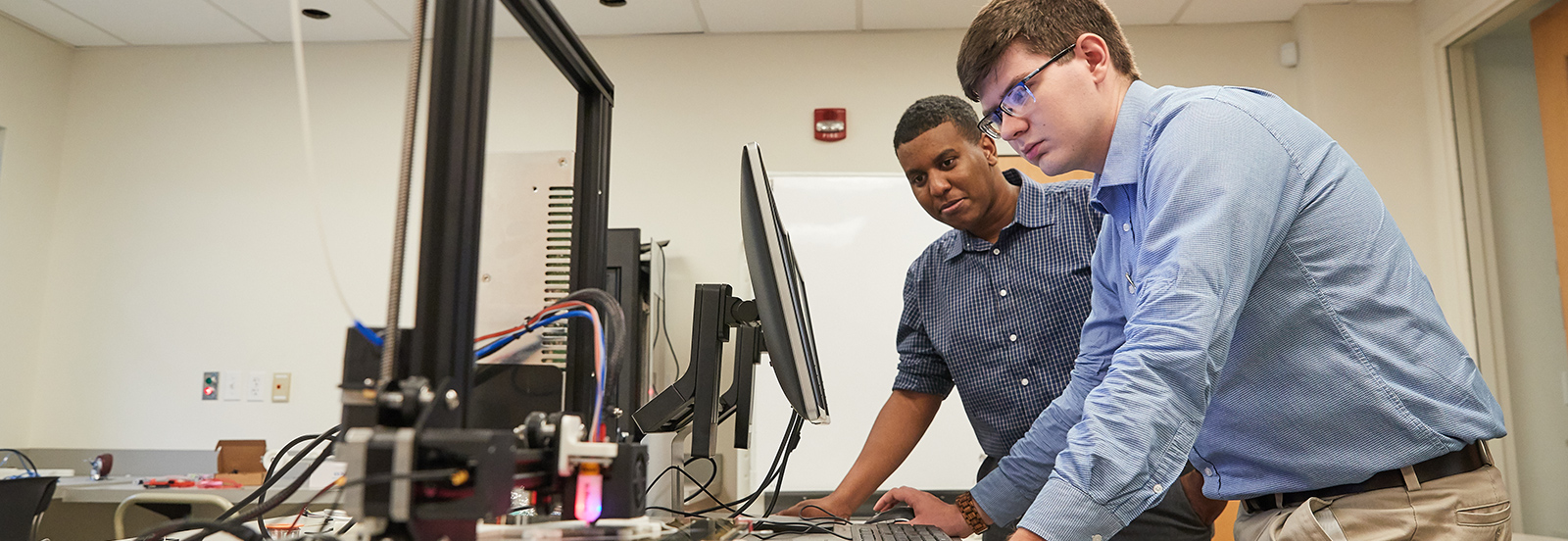 two students utilizing the technology resources at Crews Center of Entrepreneurship