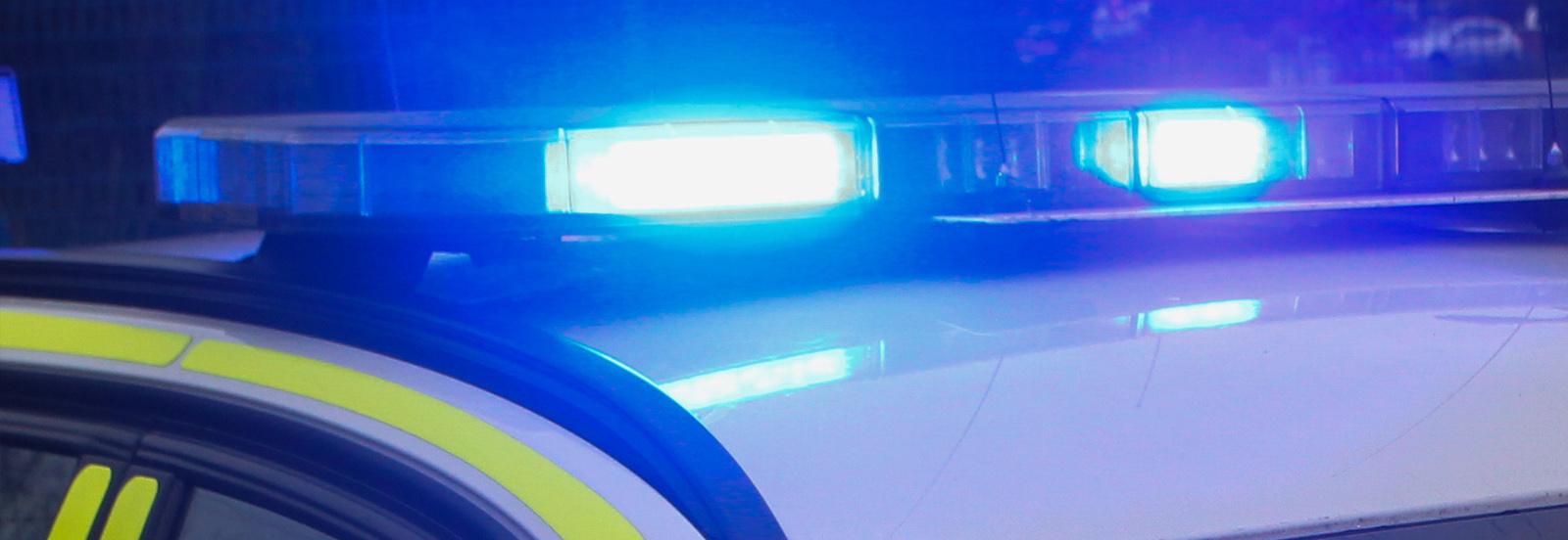 police vehicle blue light atop
