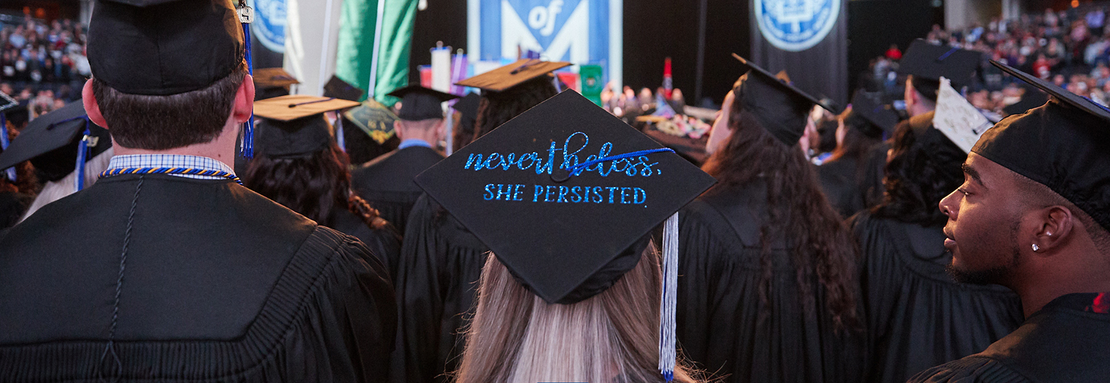 """female graduate with morter board that says """"nevertheless, she persisted"""""""