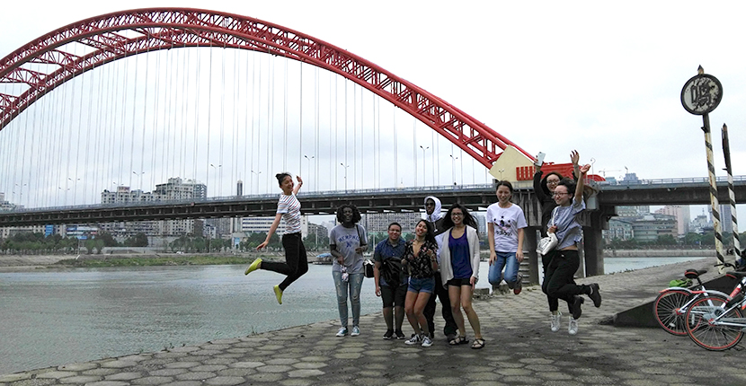 Study Abroad students along side river bank